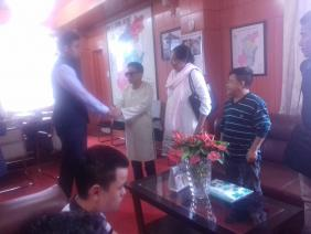 Amos  shaking hands with the DC of Kohima,, 2017