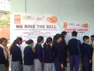 Various school students signing on the Signature Campaign for 'Ring the Bell' activity for RAISE-NE.
